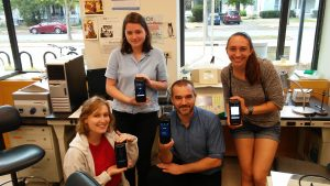 Dr. Ragland and Oberlin College students pose with the Biomeme two3.