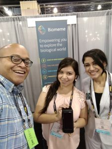 Study authors Jhomary Alegria-Berrocal (center) and Mona Alhalal (right) posing with the Biomeme two3 alongside Biomeme staff member Doug Watts (left) at the The American Society for Cell Biology Meeting 2017.