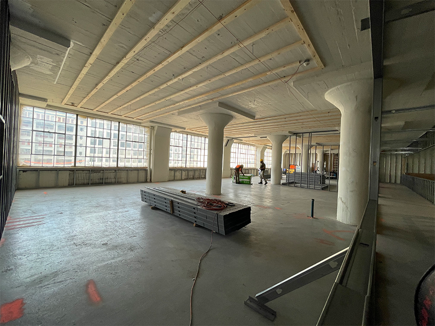 big room with construction materials in new headquarters space