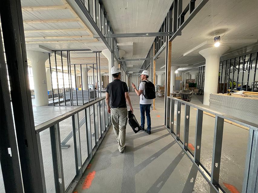 Cofounders walk through construction
