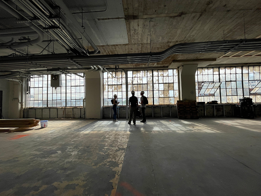 large factory windows and open space in new headquarters