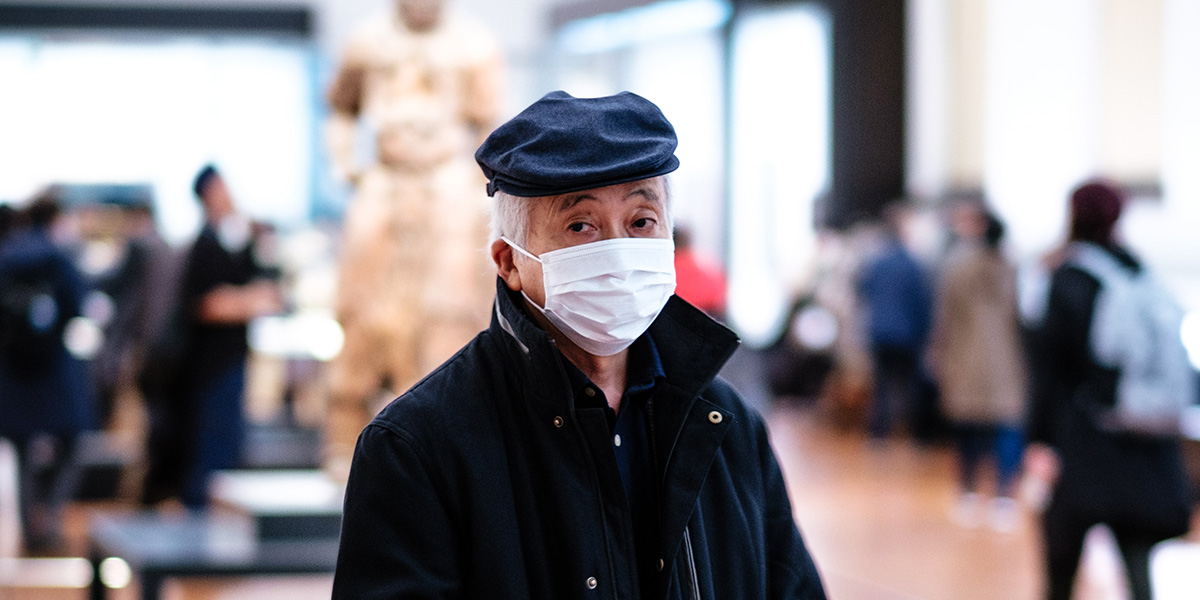 Man wearing a mask to protect himself from the 2019 Wuhan coronavirus (2019-nCoV)